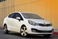 kia-rio_sedan_2012_1024x768_wallpaper_03